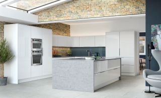 Contemporary kitchen with white gloss units