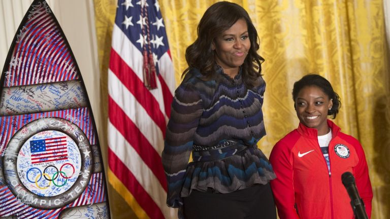 Michelle Obama's advice, US First Lady Michelle Obama and US Olympic gymnast Simone Biles during a ceremony honoring the 2016 US Olympic and Paralympic teams during an event in the East Room of the White House in Washington, DC, September 29, 2016