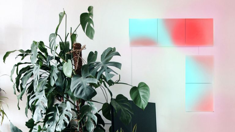 LIFX smart lighting panels in room with white scheme, houseplants and light panels