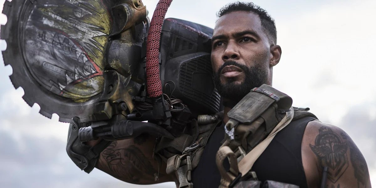 Omari Hardwick holding a super circular saw in Army of the Dead.