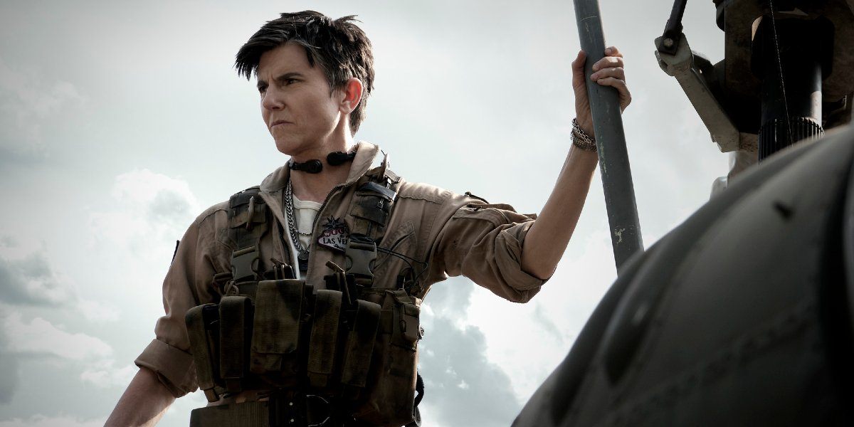 Tig Notaro staring into the distance while standing on her helicopter in Army of the Dead.