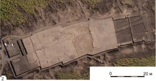 A temple dating back about 6,000 years has been discovered within a massive prehistoric settlement in Ukraine.