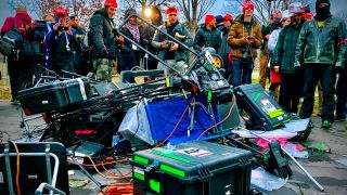Supporters of President Donald Trump stand next to media equipment they destroyed during a protest on Jan. 6, 2021 outside the Capitol in Washington, DC.