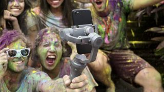 People covered in paint with a DJI osmo