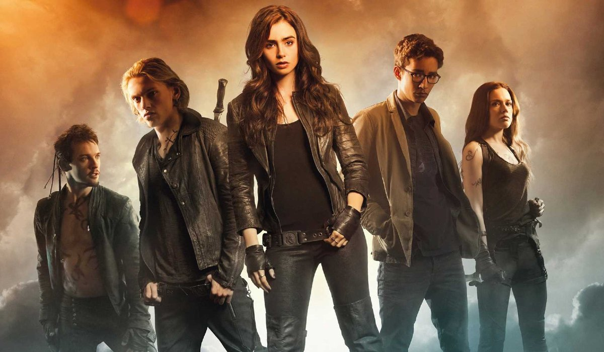 The Mortal Instruments: City of Bones Lily Collins flanked by her cast members in ominous smoke
