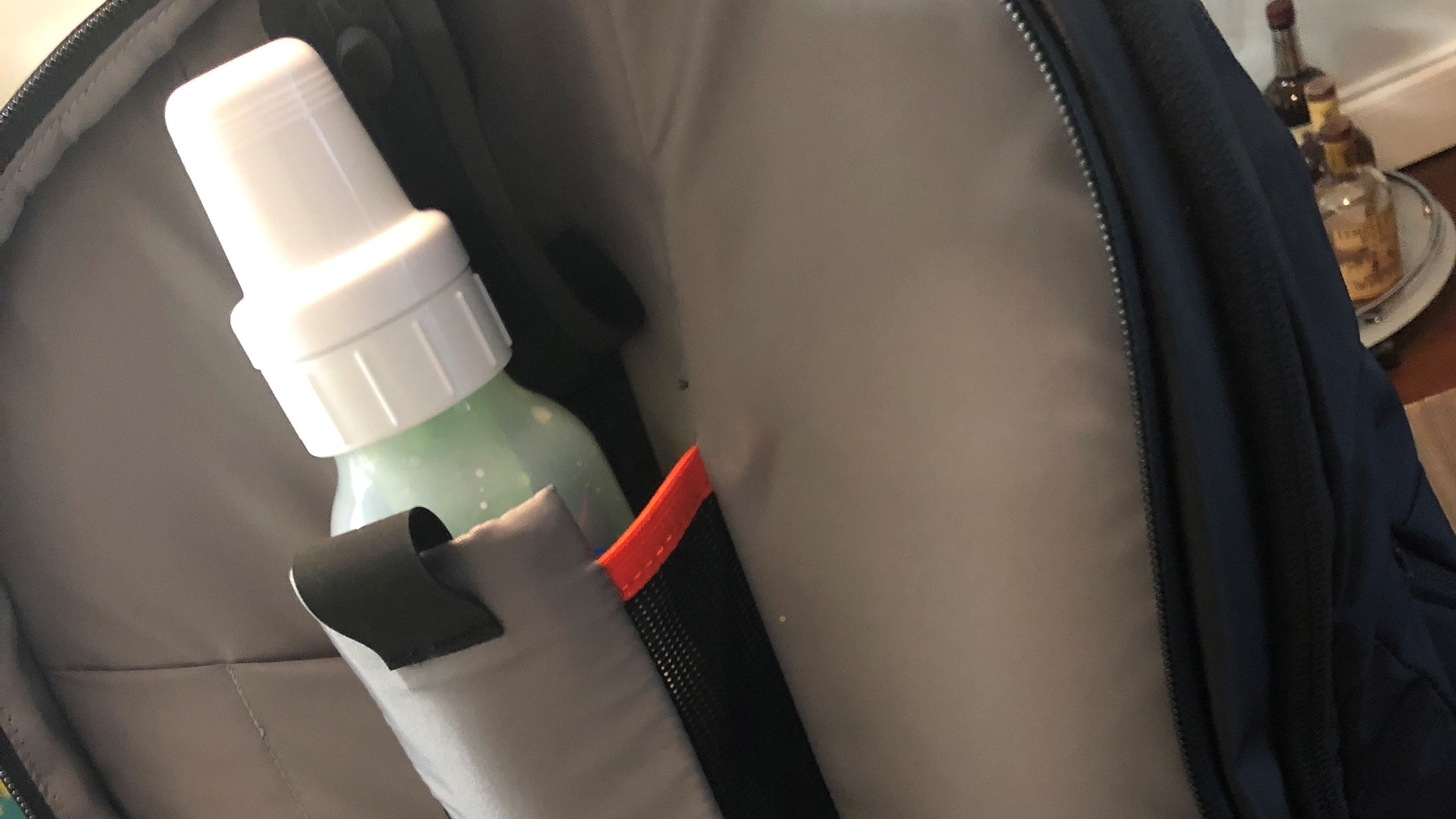 An opened BP35 backpack showing off baby bottle holder.