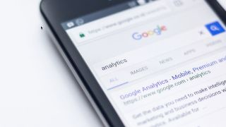 Google's search page results for analytics displayed on an iphone