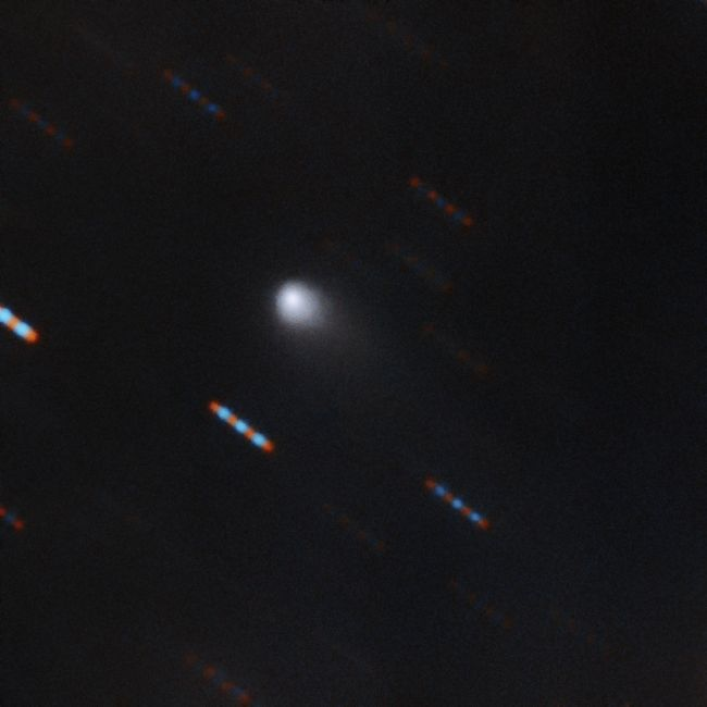 The first color image of the comet C/2019 Q4 (Borisov), which astronomers believe to be the first known interstellar comet ever identified, was captured by the Gemini North telescope at Hawaii's Mauna Kea. Gemini North acquired four 60-second exposures in two color bands (red and green). The blue and red lines are background stars moving in the background.