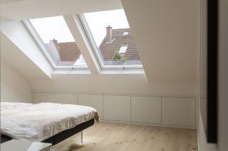 a duo of rooflights in a loft bedroom