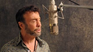 Paul Rodgers singing into a studio microphone