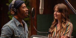 The High Note Kelvin Harrison Jr sings into the mic next to Dakota Johnson