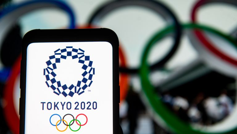 In this photo illustration a Tokyo 2020 Olympics logo seen displayed on a smartphone. (Photo Illustration by Mateusz Slodkowski/SOPA Images/LightRocket via Getty Images)