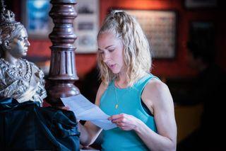 Nancy Carter reads her divorce papers in EastEnders