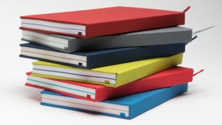 A stack of colourful notebooks