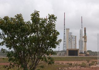 The European Ariane 5 rocket carrying the communications satellites Yahsat Y1A and New Dawn is rolled out to its South American launch pad at the Guiana Space Center in Kourou, French Guiana for a planned March 30, 2011 launch.