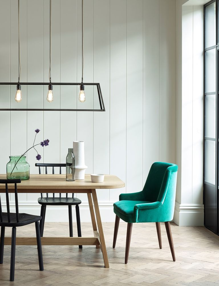 white dining room with rectangular table and chairs, with green accents