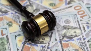 A gavel on top of a stack of money