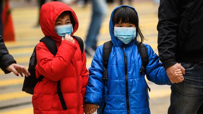 Children wear surgical masks as protection against the coronavirus as Hong Kong marked the Lunar New Year on Jan. 27, 2020.