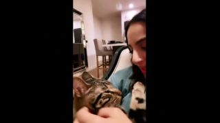 Owner singing 'you are my sunshine' to cat