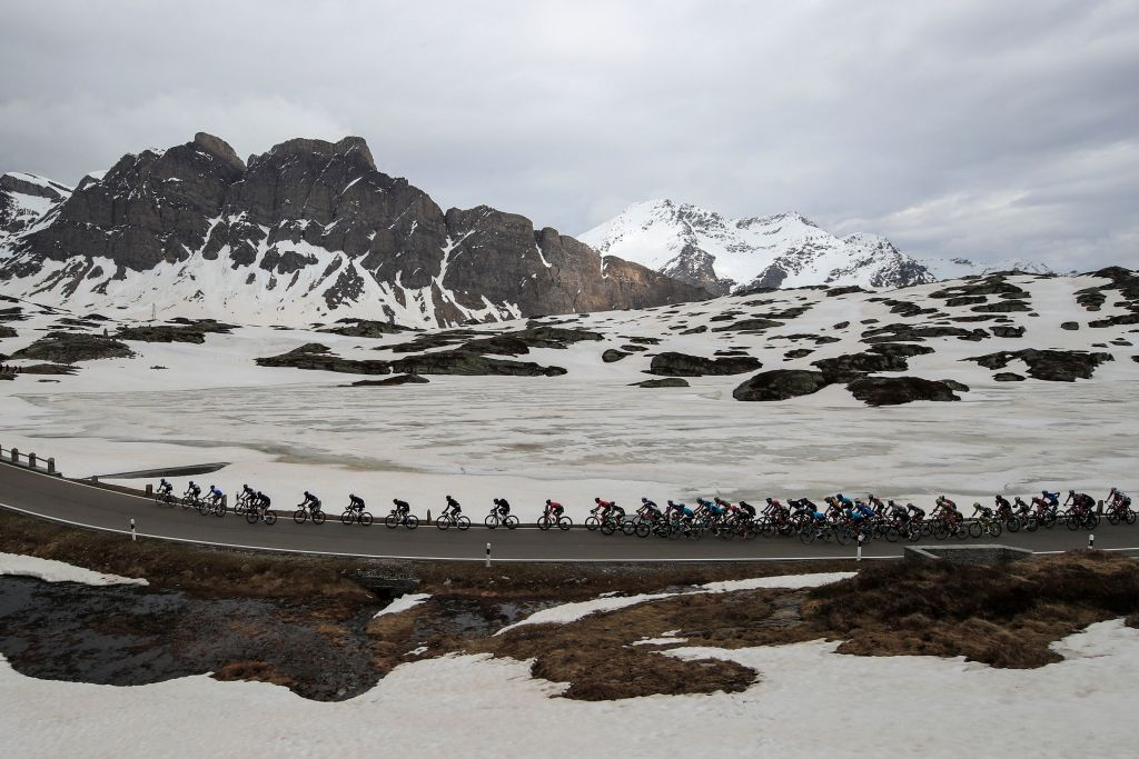 The pack rides across the San Bernardino pass Switzerland during the 20th stage of the Giro dItalia 2021 cycling race 164km between Verbania and Valle Spluga Alpe Motta Madesimo on May 29 2021 Photo by Luca Bettini AFP Photo by LUCA BETTINIAFP via Getty Images
