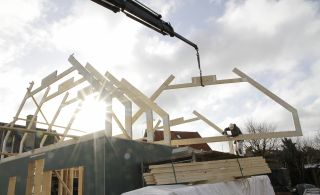 how much does it cost to build a house with a timber frame?