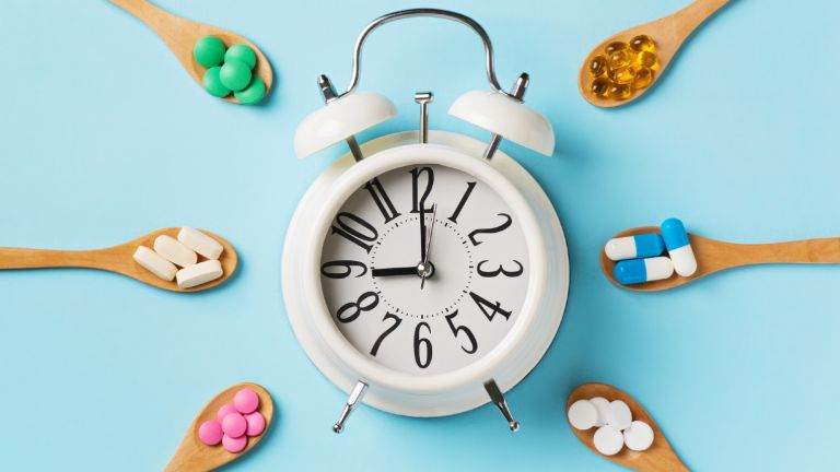 Supplements for sleep in spoons around a clock