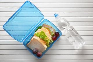 An image of a plastic bottle and plastic lunchbox.