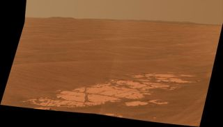 Image from NASA's Mars Rover Opportunity panoramic camera capturing the rim of Endeavour crater on Mars.