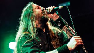 A picture of Ben Ward of Orange Goblin on stage