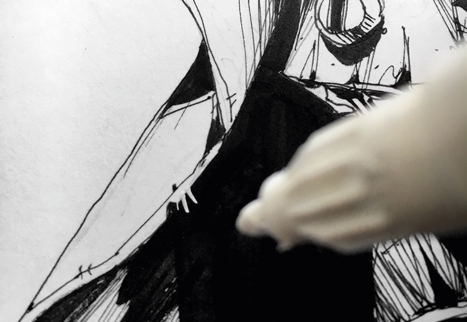 A white paint pen hovers above the drawing