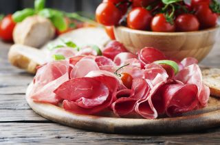 Antipasto with ham and bresaola, selective focus