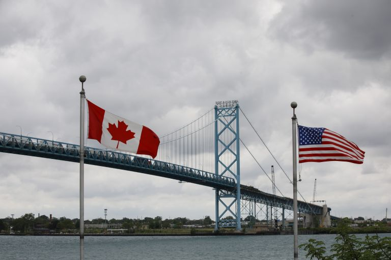 canadian and american flags at the U.S.-Canada border