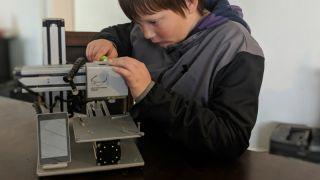Boy fixing printer