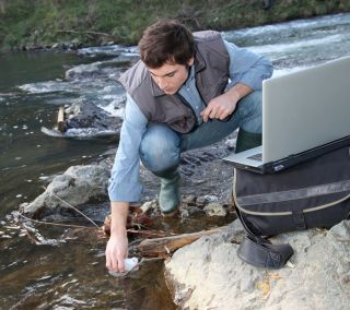 Environmental engineer checks water quality
