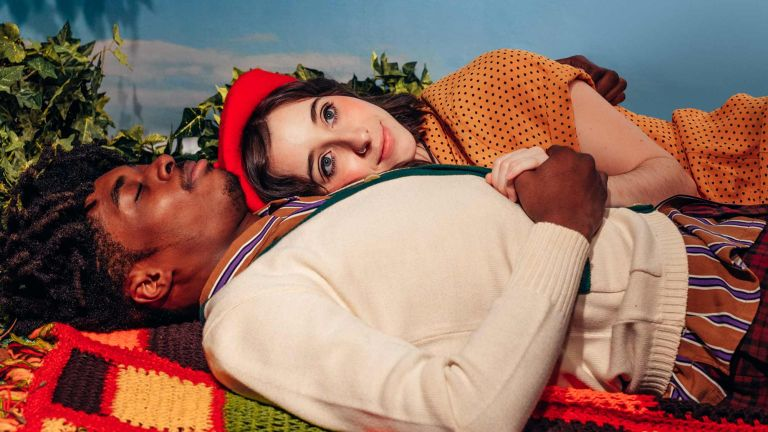 Young Couple Laying on Blanket Outside