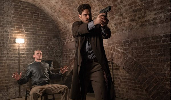 Mission: Impossible - Fallout Henry Cavill aims a gun, while Simon Pegg watches
