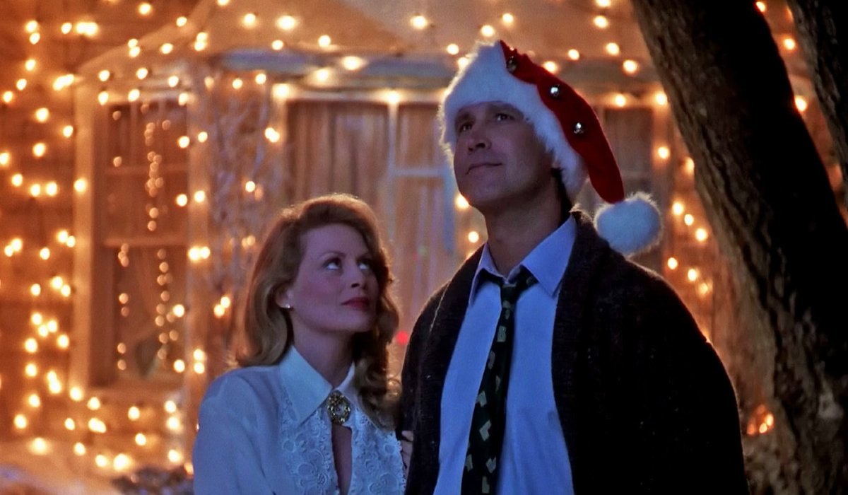 National Lampoon's Christmas Vacation the Griswolds outside on a moonlit night