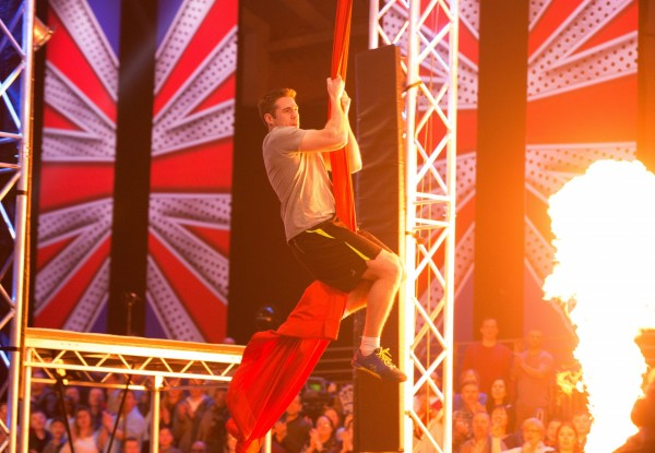 A contestant attempting to climb the rope (Rachel Joseph/ITV)