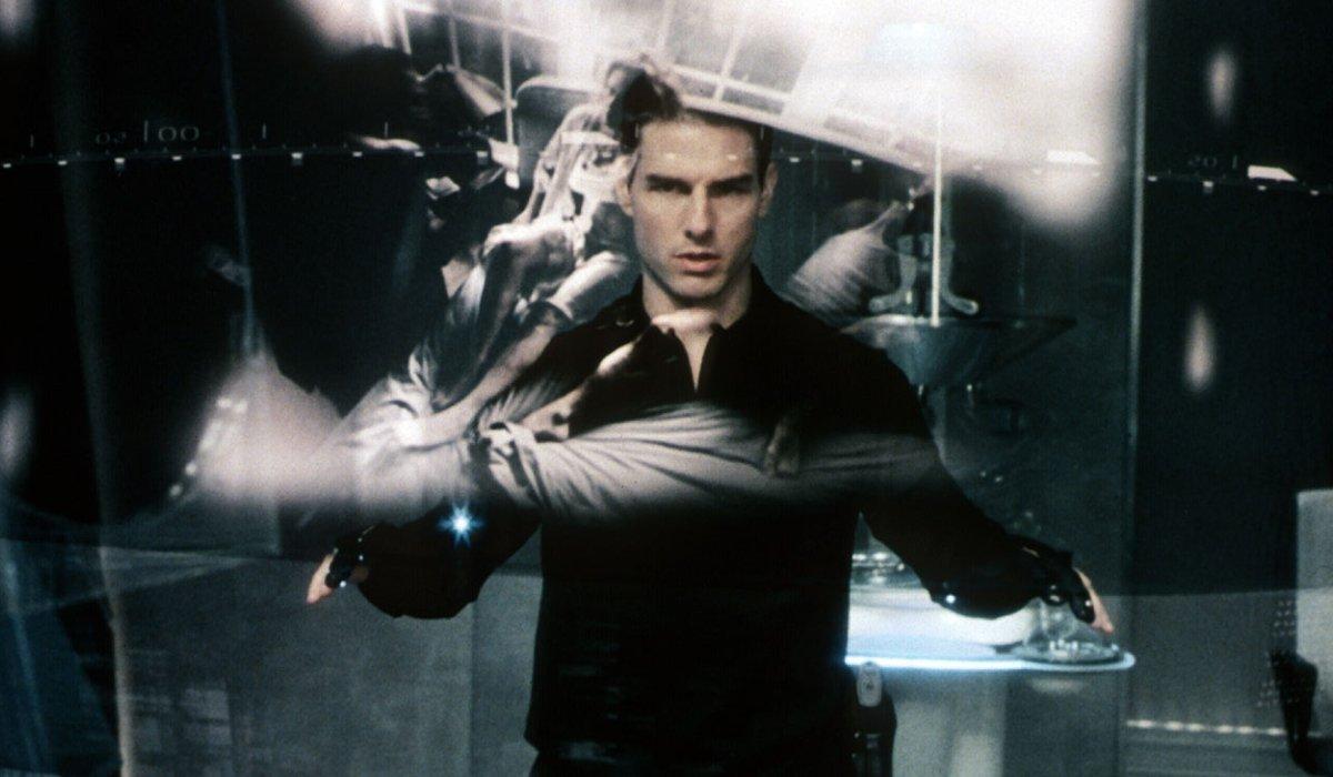 Minority Report Tom Cruise examines futuristic evidence