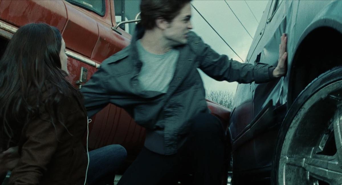 Edward saving Bella from the van