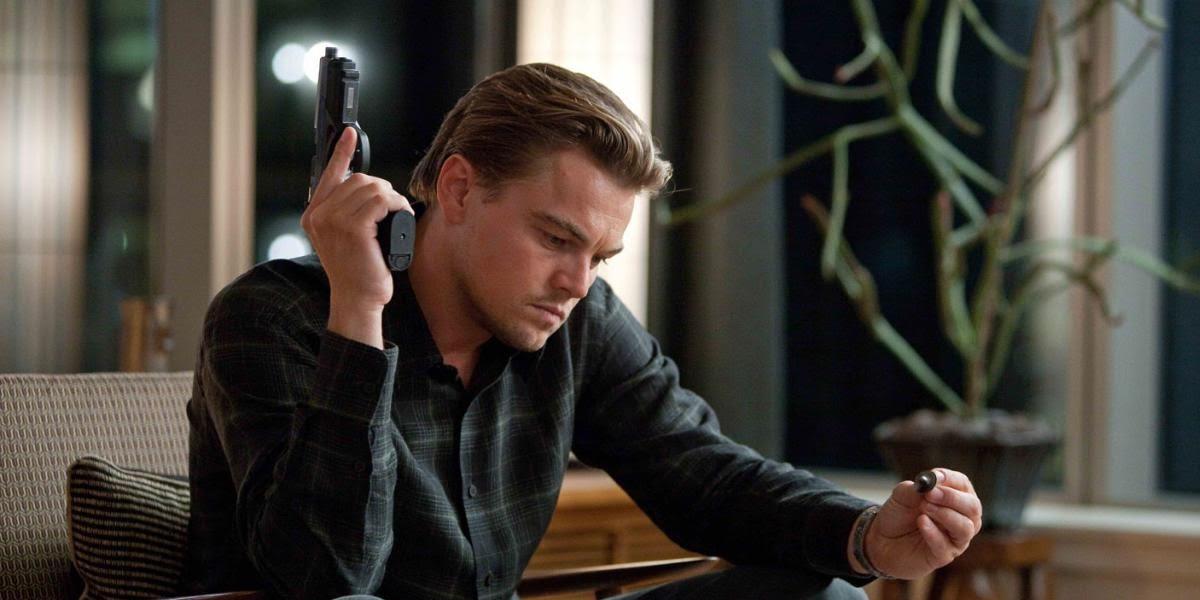 Leo DiCaprio holding a gun