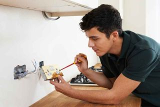 electrician with plug socket