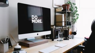 The best website builders empower your business to do more. Picture shows DO MORE on Mac desktop with screen.