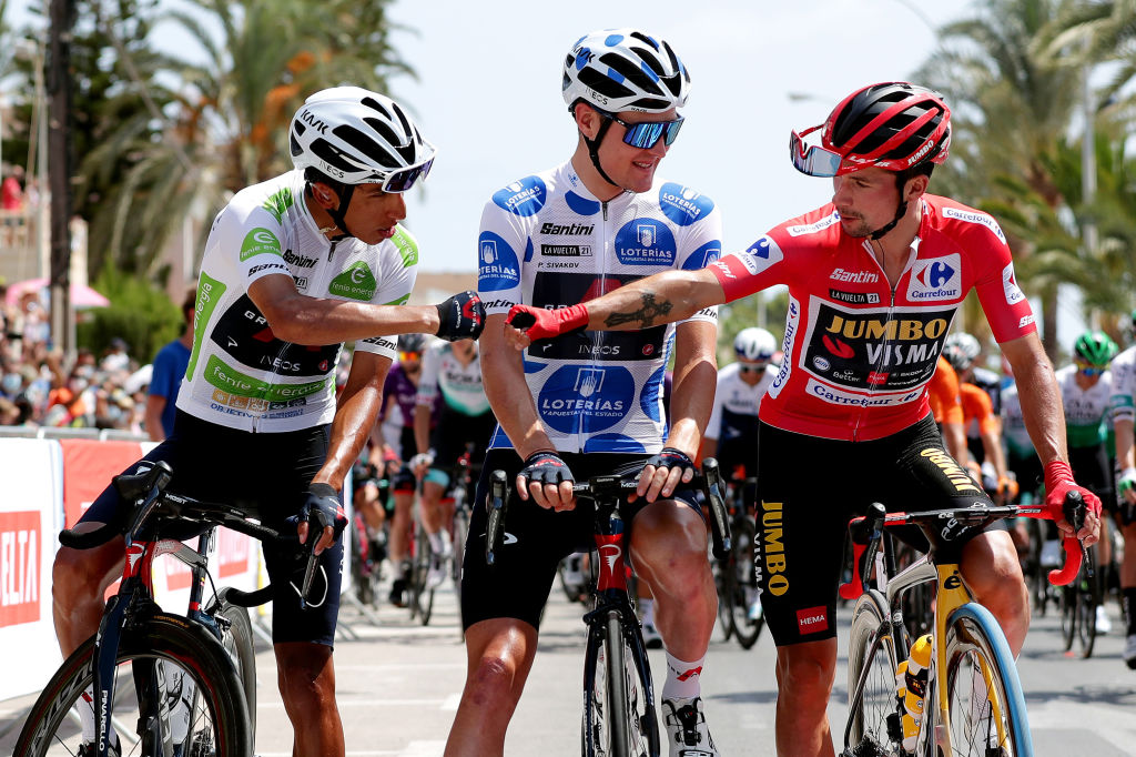 Egan Bernal Primoz Roglic swap fist pumps before the start of stage 9