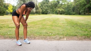 How to start running: Image shows woman taking breath after a run