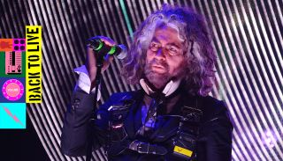 A photograph of Wayne Coyne of the Flaming Lips performing live on stage