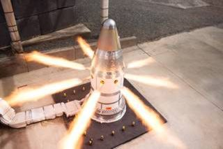 The attitude control motor fires during a test at Northrop Grumman's facility in Elkton, Maryland.