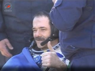 Canadian astronaut Chris Hadfield gives a thumb's up sign after successfully returning to Earth on May 14, 2013 (May 13 EDT) aboard a Soyuz space capsule following a five month mission. Hadfield commanded the Expedition 35 mission to the International Spa