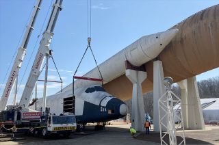 """The space shuttle orbiter mockup Pathfinder """"lands"""" on the ground to be assessed for a multi-million-dollar restoration after 30 years on display atop an external tank and two solid rocket boosters at the U.S. Space & Rocket Center in Huntsville, Alabama."""