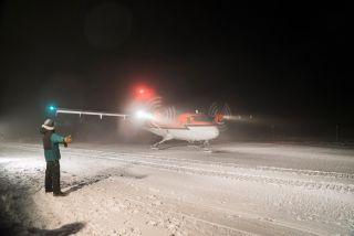 A Twin Otter aircraft lands successfully at the Amundsen-Scott South Pole Station, in order to evacuate a sick resident of the National Science Foundation's Antarctic base.